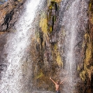 034_TZmN.7715V-Man-Under-Waterfall-N-Zambia