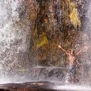 035_TZmN.7716-Man-Under-Waterfall-N-Zambia