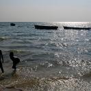 052_TZmN.8152-Lake-Mweru-Boats-&-Children-Bathing-N-Zambia
