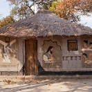 001_CZmA.8530-African-Painted-House-Jesus's-Barbshop-NW-Zambia