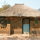 011_CZmA.8651-African-Painted-House-Only-God-Will-Charge