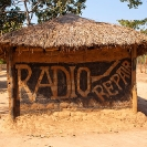 012_CZmA.8664-African-Painted-House-Radio-Repair