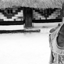 001_PZmN.8033BW-African-Painted-House-&-Owner-N-Zambia