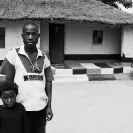 016_PZmN.8063BW-African-Painted-House-&-Owner-N-Zambia