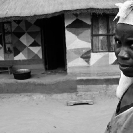 019_PZmN.8075BW-African-Painted-House-&-Owner-N-Zambia