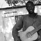 012_CZmA.8676BW-Village-Shop-Owner-Brother-Soon-&-Owner-Zambia