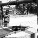 027_CZmA.8548BW-African-Village-Girl-&-Carved-Water-Well-NW-Zambia