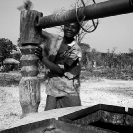 028_CZmA.8344BW-African-Village-Woman-&-Carved-Water-Well-NW-Zambia