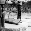 029_CZmA.8796BW-African-Carved-Water-Well-&-Village-Woman-NW-Zambia