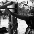 030_CZmA.8800BW-African-Village-Woman-&-Carved-Water-Well-NW-Zambia